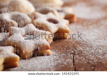 Christmas cookies and pouring sugar- Selective focus and place for copy space.