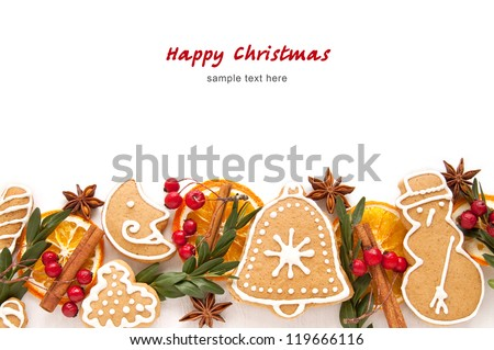 Christmas cookies and spices over white background close up