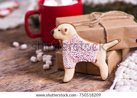 Christmas cookies. Christmas cookies with festive decoration.  Cookies in the shape of a dog. symbol of the year. Dog symbol of the year 2018 #750518209