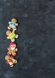Christmas cookies ginger men with colored glaze on a gray background