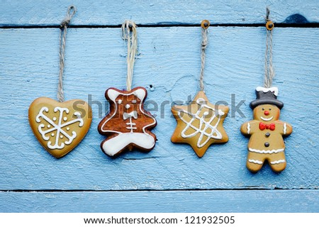 Christmas cookies hanging over wooden background