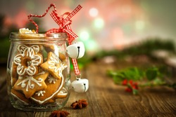 Christmas Cookies in a jar on Wooden background with Christmas Holly