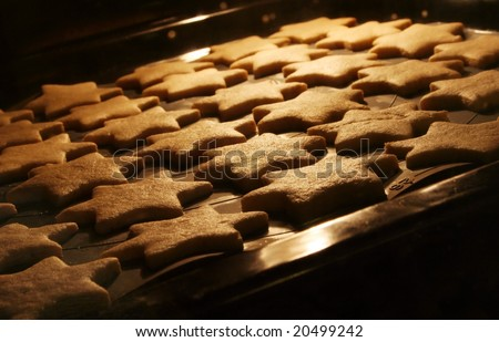 Christmas cookies in the oven - warm light, festive atmosphere