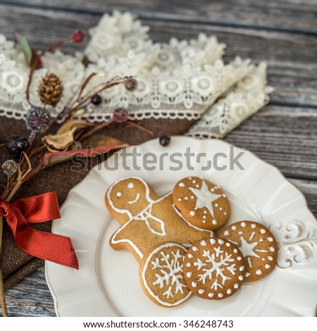 Christmas cookies in white plate on wooden table #346248743