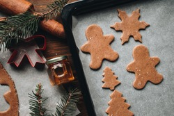 Christmas cookies. Making gingerbread cookies for Holidays. Gingerbread dough. Christmas Baking background. Form for cutting gingerbread. Merry Christmas and Happy Holidays.