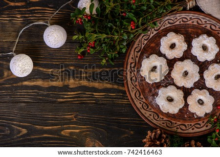 Christmas cookies. Mexican wedding cookies in flower shape. Christmas and New year food. Christmas decoration, cowberry and sweets on wood background #742416463