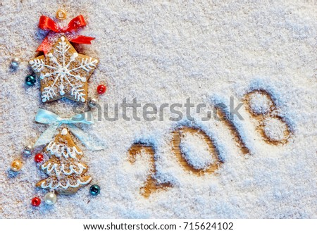 Christmas cookies on snowy background with inscription 2018. Merry Christmas and Happy New Year!! Top view. High resolution product