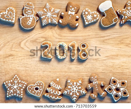 Christmas cookies on wooden table. Merry Christmas and Happy new year 2018! Top view. High resolution product #713703559
