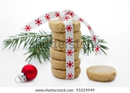 Christmas Cookies piled up with fir twig and xmas ball