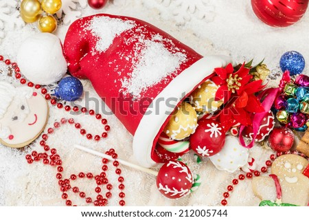 Christmas Cookies. Sweet Sugar  Santa Hat, decorated with festive royal icing and Christmas cookies on festive table. Selective focus