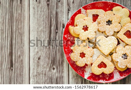Christmas cookies with jam on wooden table #1562978617