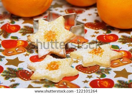 Christmas cookies with orange peel, stars made of biscuit dough with orange flavor