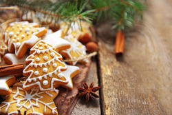Christmas cookies with spices on wooden table