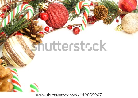 Christmas corner border with baubles, tree branches and candy canes over white