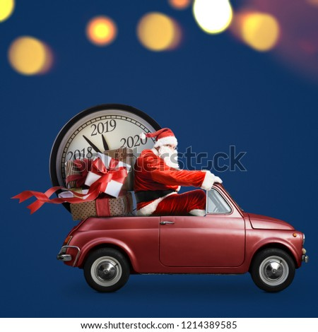Christmas countdown arriving. Santa Claus on car delivering New Year gifts and clock at blue background #1214389585