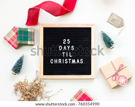 Christmas countdown on a black letter board with a wooden frame. 25 Days Til Christmas image for social media. #760354990