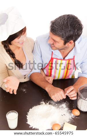 christmas couple baking  with flour at home in kitchen