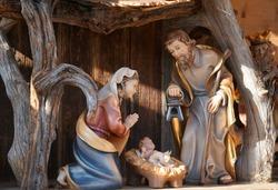 Christmas Crib. Wood Figures. Beautiful Festive Christmas Background And Close Up.