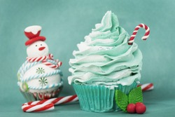 Christmas cupcake with candy cane and snowman