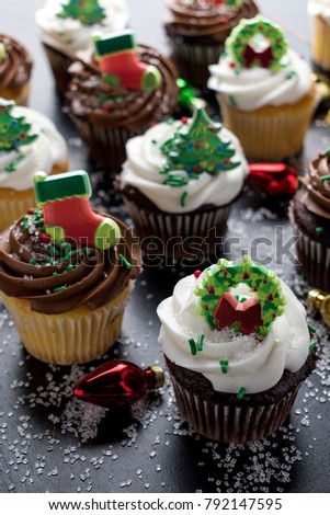 christmas cupcakes with decorations and sprinkles 792147595