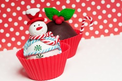 Christmas cupcakes with holly and snowman