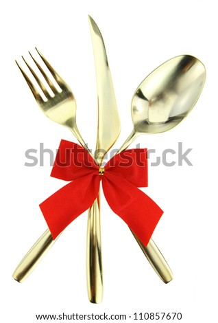 Christmas cutlery. Spoon, fork and knife stacked up on white background