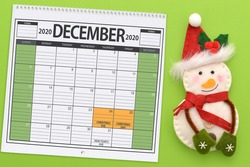 Christmas December 2020 Calendar with snowman on green background