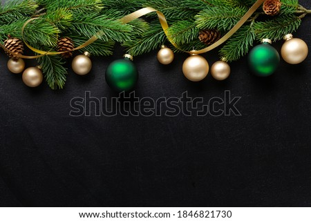 Photo of  Christmas deco with fir and baubles on dark background. Flat Lay. Christmas concept