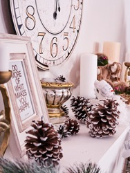 Christmas decor, New Year's card scenery, New Year Clock with candles and photoframe. New Year concept.