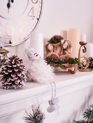 Christmas decor, New Year's card scenery, New Year Clock with candles, snowman and photoframe. New Year concept