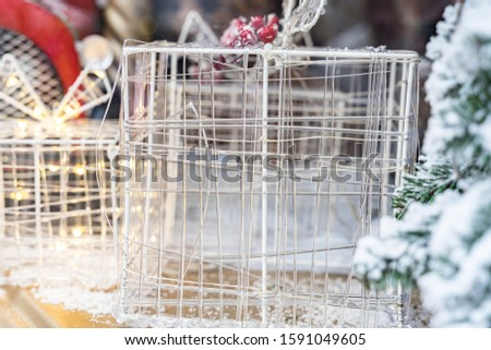 Christmas decor. silver box on the wind of the shop of the insider