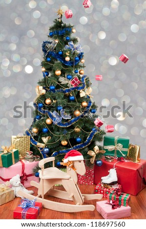 Christmas - Decorated christmas tree with lots of gifts and toys - falling presents