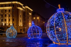 Christmas decorated city of St. Petersburg, Russia. Large glowing Christmas balls