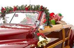 Christmas decorated classic Car. A vintage car decorated for the holidays loaded with festive gifts A classic Christmas car decorated with bells and garland and loaded with presents
