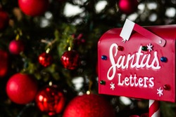 Christmas decorated mailbox for letters to Santa Claus. Christmas and New Year traditions to order gifts by mail from Santa