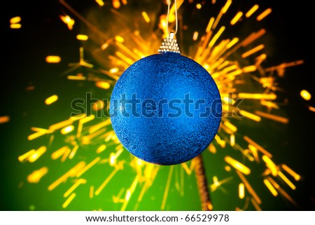 Christmas decoration against sparklers background