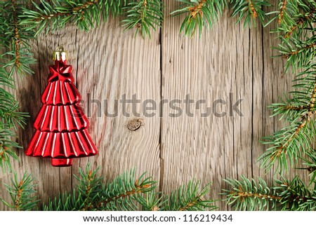 Christmas decoration and christmas tree branches on wooden background