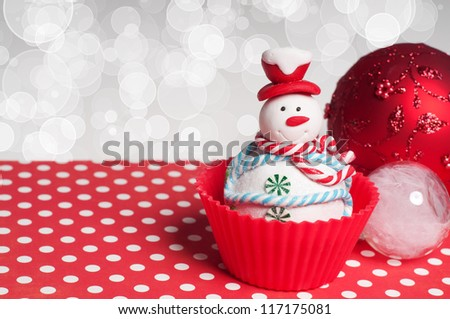 Christmas decoration and cupcake on bokeh background