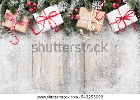 Christmas decoration and gift boxes on wooden background #543253099