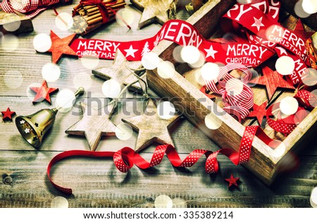 Christmas decoration and ornaments on rustic wooden background. Retro style dark colored picture with light effects #335389214