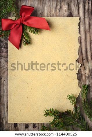 Christmas decoration and vintage paper on wooden background