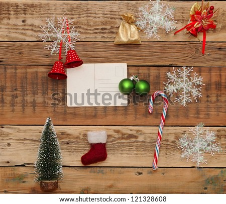 Christmas decoration and vintage postcard on the wood background