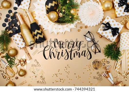 Christmas decoration background in golden and black colors. Flat lay, top view