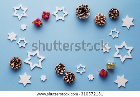 Christmas decoration background over blue background, above view with copy space for text or other design
