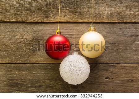 Christmas decoration balls hanging on a wooden wall