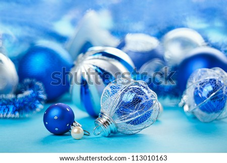 Christmas decoration balls on blue background, closeup