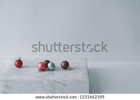 Christmas decoration balls on marble. Minimal style background. #1231662349
