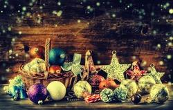 Christmas decoration balls stars jingle bells in wooden basket.