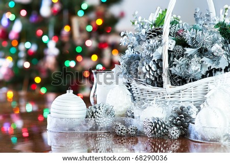 Christmas decoration basket in silver, white with tree background