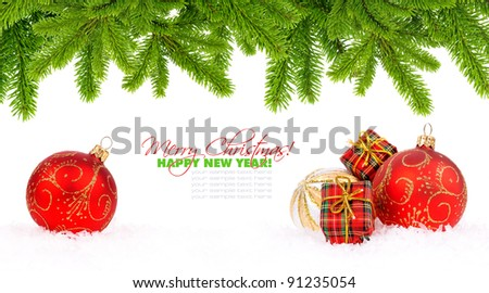 Christmas decoration baubles and pine on white with space for text